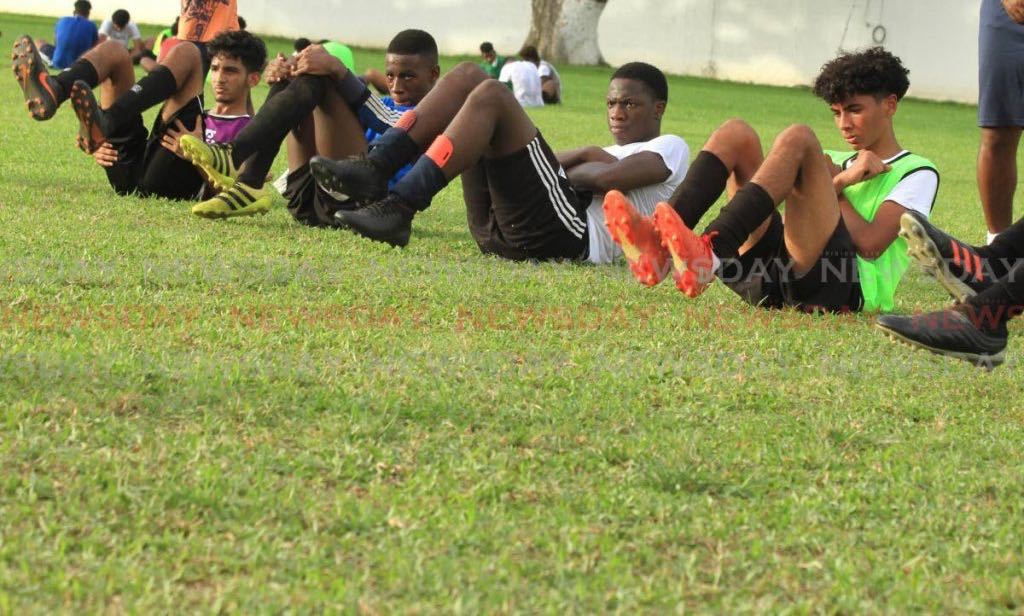 Members of the St Mary's College Under16 football team go through some exercises during the team's first training session since an ease on covid19 safety restrictions, at the CIC Grounds, St Clair, on Monday. - Ayanna Kinsale