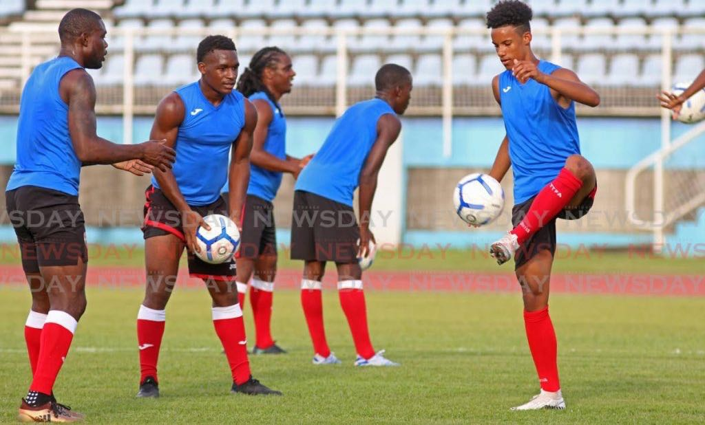 Gary Griffith III, right, takes part in a T&T senior men's team football training session, at the Ato Boldon Stadium, Couva, on Tuesday. T&T are due to play a friendly against the US on January 31. - Marvin Hamilton
