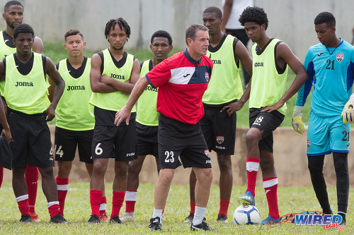 Photo: Soca Warriors coach Terry Fenwick (centre) demonstrates to his players during training at the Police Barracks, St James on 3 July 2020. (Copyright Allan V Crane/CA-Images/Wired868)