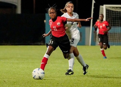 Miakayla St Clair (on ball) of T&T holds off Cuba's Cinthia Canoto to keep the ball during their CFU Girls' Under-14 match in the Challenge Series at the Ato Boldon Stadium in Couva on Tuesday. Cuba won 2-1. ...Daniel Prentice/CA-images