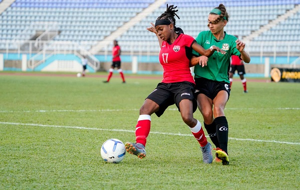 T&T's Aaliyah Prince, left, on the ball against St Kitts and Nevis in the Concacaf Women's Olympic Zone Qualifiers, at the Ato Boldon Stadium, Couva,on Sunday. PHOTO BY DANIEL PRENTICE/CA-images