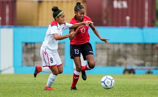 T&T's Arjoon Summer, right, is harassed by Dominican Republic's Nicole De Jesus during their Concacaf Women's Olympic Zone Qualifier at the Ato Boldon Stadium in Couva yesterday. The match ended 0-0.