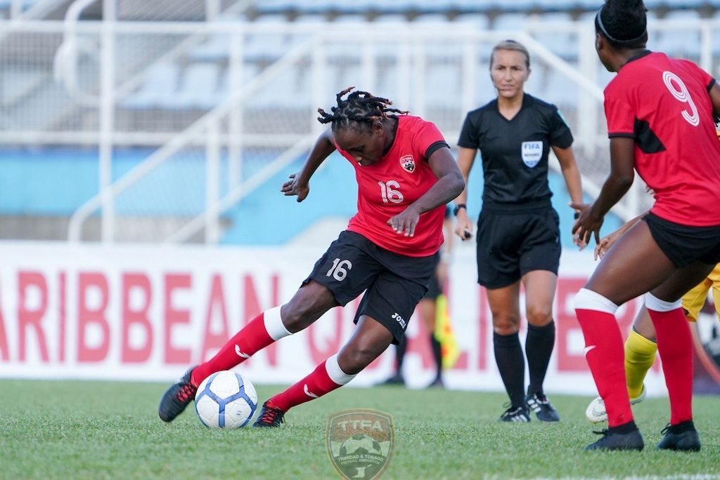 Dennecia Prince, left, scored the lone item for T&T in the host team's 4-1 loss to St Kitts and Nevis in their Group A CONCACAF Women's Olympic Qualifier at Ato Boldon Stadium, Couva, yesterday.