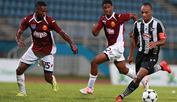 Central FC captain and midfielder Leston Paul, right, during FridayÂ's 2014 First Citizens Cup Final at the Ato Boldon Stadium. Keeping close chase are North East Stars defender Keryn Navarro, #25, and substitute Taryk Sampson. (ttproleague).