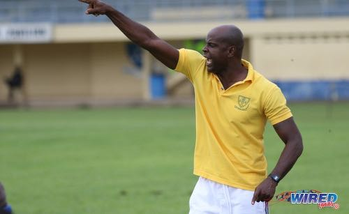 Photo: St Benedict's College coach Leonson Lewis points the way forward for his team during SSFL Premier Division action against East Mucurapo at Mucurapo Road on 6 October 2016. ...Lewis is also a Trinidad and Tobago National Under-13 Team assistant coach and W Connection youth coach. ...(Courtesy Sean Morrison/Wired868)