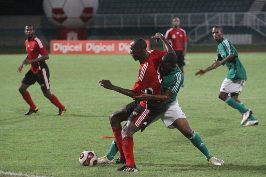 Daniel Cyrus (in red) being marked by a Guyanese attacker.