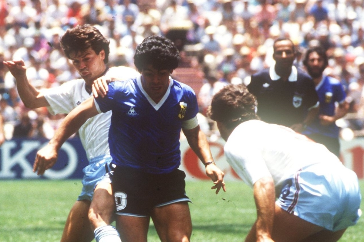 English defenders Terry Fenwick (left) and Kenny Sansom (right) try to stop Argentinian ace midfielder and goalgetter Diego Maradona. On the way to the title the Argentinian national team won their World Cup quarter final match against England in front of 114,600 spectators at the Aztec Stadium in Mexico City, Mexico on 22 June 1986by a final score of 2-1 with Maradona scoring both legendary goals for his team. (Photo by /picture alliance via Getty Images)