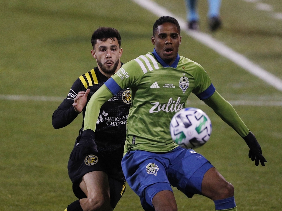 Dec 12, 2020; Columbus, Ohio, USA; Seattle Sounders defender Joevin Jones (33) battles for the ball with Columbus Crew defender Milton Valenzuela (19) in the first half during the 2020 MLS Cup Final at MAPFRE Stadium. Mandatory Credit: Trevor Ruszkowski-USA TODAY Sports