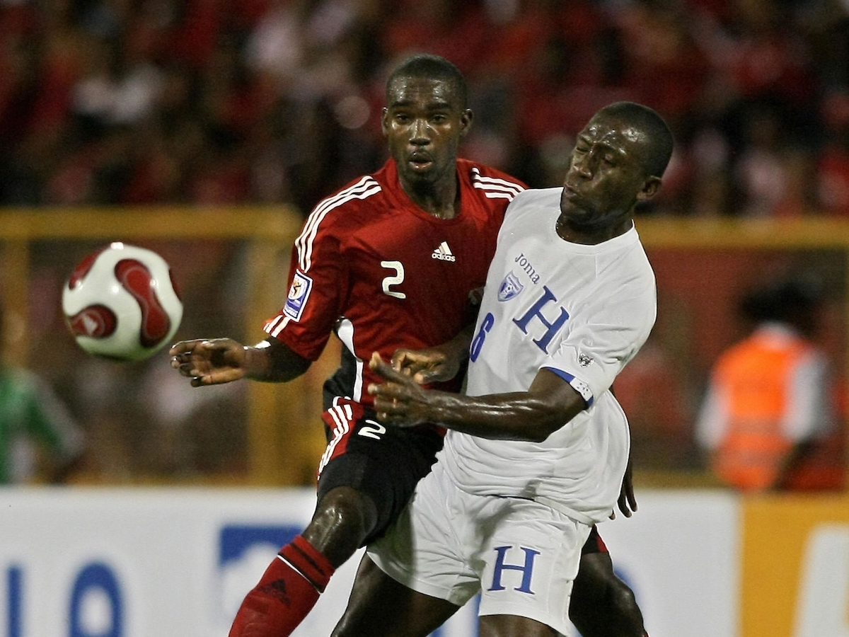 Trinidad and Tobago's Clyde Leon (L) vies for the ball with Honduras' Hendry Thomas during their FIFA World Cup South Africa-2010 qualifier football match at Hasely Crawford stadium in Port of Spain on March 28, 2009. (THOMAS COEX AFP PHOTO via Getty Images)