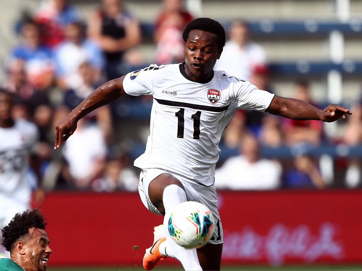 Levi Garcia of Trinidad and Tobago controls the ball as Terence Vancooten of Guyana attempts to slide tackle during the first half of the CONCACAF Gold Cup match at Children's Mercy Park on June 26, 2019 in Kansas City, Kansas. (Photo by Jamie Squire/Getty Images)