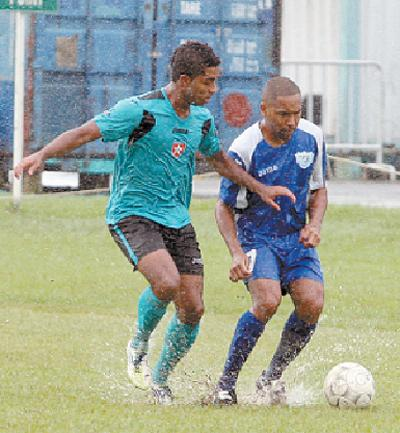 WASA FC midfielder Fabian Garcia, right, in a battle of number 7s with Westside Superstarz's Qian Grosvenor, in the blink/bmobile National Super League clash, on Sunday. The match was eventually abandoned due a waterlogged pitch, at WASA Ground, St Joseph. Photo: Anthony Harris.